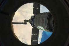 Through a porthole in the International Space Station, NASA astronaut Rick Mastracchio caught this view of Orbital Sciences Corp.'s Cygnus cargo spacecraft departing Feb. 18, over the Middle East.