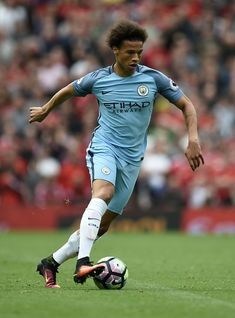 Manchester City's German midfielder Leroy Sane runs with the ball during the…
