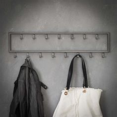 This industrial coat rack Max is made of grey powder-coated metal. In total, this model has 15 hooks. Available from stock at Furnwise. Industrial Coat Rack, Industrial Wall Shelves, Industrial Floor Lamps, Coat Hooks Hallway, Hall House, Wooden Coat Rack, Wall Racks, House Doctor, Affordable Furniture