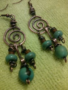 Artisan copper earrings <3  ~Gaea's Gifts by Bryn~. I especially like the middle forged links
