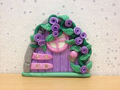 Clay Fairy Door with Purple Flowers. Magical fairy door, perfect for any little girl or boy or even a grown up. Great for the tooth fairy, the dummy fairy, story telling or simply for them to leave little letters for their fairy and tell them their worries. #teelieslavender
