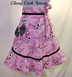Half Apron Glam Girly Goth Skulls in Glitter Pink & Black, Ruffled Flounce, Pretty Party Kitchen Gift. $27.50, via Etsy.