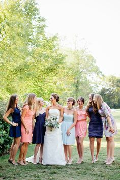 Bridesmaids in navy, coral peach, and sky blue dresses in personalized styles - summer southern chic with a touch of nautical