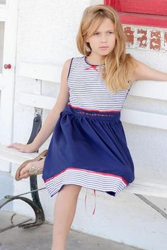 Classic navy blue dress with sailor striped bodice and elegant red floral hand-embroidery along the waist. Vintage inspired, timeless and ethical kids clothing. Nautical Summer Dresses, Navy Blue Dresses, Girls Dresses, Vintage Inspired, Bodice, Kids Outfits, Elegant, Inspiration, Clothes