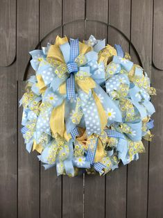 This sweet wreath features soft shades of blue and yellow. This premium deco mesh wreath is loaded with beautiful coordinating ribbons. Summer Door Wreaths, Easter Wreaths, Wreaths For Front Door, Spring Wreaths, Black Wreath, Purple Wreath, Dog Wreath, Heart Wreath, Floral Clutch Bags