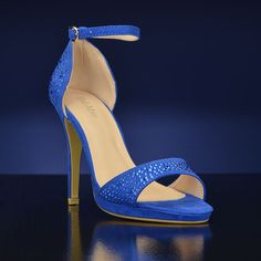 """""""Nine-10"""" by Bella Marie. This royal blue shoe boasts a 4 inch heel and a 1/2 inch platform.  The crystal studded heel cuff and ankle strap design will keep Nine in place while you dance the night away!  Nine is made in a micro suede fabric and features a full open toe adorned with blue crystals for that extra sparkle. $36.00. http://www.bridalshoes.com/NINE-10"""