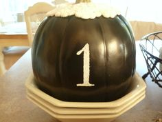 Kate's Place - spray paint pumpkin black,glue on doily, stencil numbers