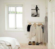 separate wall mounted clothing rack for next day's outfit
