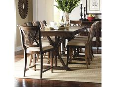 Update your dining area with the simple and sophisticated style of this pub dining set. The trestle pub table features tall X-shaped pedestals, helping you to make the most of the space available in your dining room. An Amber finish gives the piece a relaxed, warm appearance, while the graphic pedestals create a contemporary silhouette. Seat up to eight people with the included 18 inch leaf and pub chairs, which feature tapered legs and a double X shape on the chair back for a contemporary…