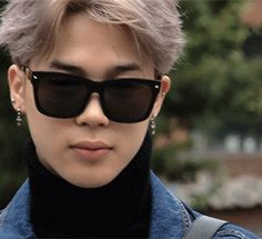 Ok....well one his hair is just beautiful...the sunglasses (yesss) and the cross earnings (also yesssss)