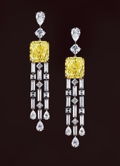 Leviev. HAUTE JOALLERIE FANCY INTENSE YELLOW DIAMOND EARRINGS. Two radiant-cut Fancy Intense Yellow Internally Flawless diamonds weighing a total of 25.11 carats mounted with two square-emerald, eight pear, fourteen carre and eighteen baguette-cut diamonds totaling 14.23 carats, handcrafted in platinum and 18 karat yellow gold.