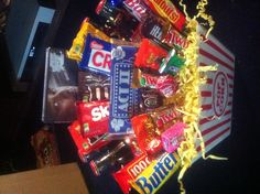 Movie/candy basket Raffle Baskets, Gift Baskets, Candy Baskets, Birthday Candy, Birthday Gifts, Movie Candy, Movie Night Gift Basket, Candy Bouquet, Candy Gifts