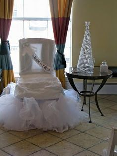 Oh how funny - the bride chair at a shower.  Looks like someone made good use of their old crinoline slip!