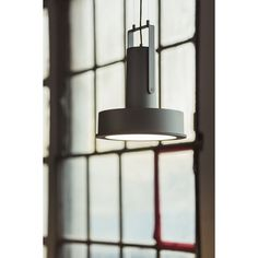 modern industrial pendant lighting with the ARNE spotlight design by Santa Cole team using LEDs seen at Euroluce