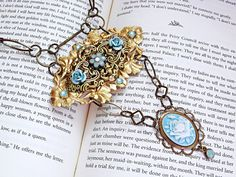 $68  Breathtaking romantic Victorian/ Edwardian style necklace. Swarovski Pacific Opal crystals and a blue flower cameo. Get this in my shop now!