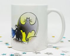 Its a bird, its a plane ...... no its BATCAT COMING TO EAT YOUR FACE! Our Batcat card has done so well, we decided to make it a mug! Now you can drink your cup of awesome with this fantastic little furry creature..... this is a perfect gift for any cat lover, especially if they love the bat crazy superhero!   ♥♥ Important Information ♥♥  ♥ Our mugs are an 11 oz regular coffee mug, which means you get more than a cup of awesome goodness!  ♥ Each mug design is printed on both sides- it doesnt…