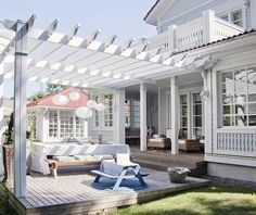 Trellis, pergola, they all stem from the same architectural idea. Lose the deck, pour a few steps down to flagstone and grass patio under a pergola. I want this smooth transition from it to the yard. Coastal Cottage, House Design, Cottage, Outside Living, Outdoor Rooms, House Exterior, Decks And Porches, Coastal Living, Pergola Designs