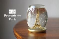 Simplette: DIY - Souvenir de Paris - cute snow globe made with glitter, baby oil and a recycled jar plus an extra lid