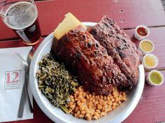 """12 Bones Smokehouse, Asheville NC. """"Everything here is amazing, from the ribs (pictured above) to the corn pudding, but the BLT is ridiculous: house-cured brown-sugar bacon, fried green tomatoes, and pesto mayonnaise on thick slices of wheat bread."""""""