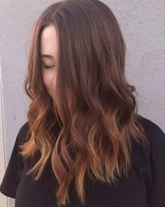 Latest cut - shoulder length brunette hair with subtle balayage type ends