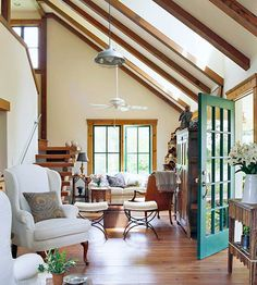 Explore these beautiful open living room designs. Get 15+ ideas here: http://www.bhg.com/rooms/living-room/room-arranging/open-floor-plans/?socsrc=bhgpin011915historicopenfloorplans&page=3