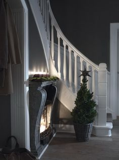 Black / dark grey fireplace in hallway | Interior: Architect Fossland AS / int. sheets. Elin Fossland  house from 1860