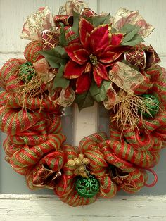 Christmas Deco Mesh Wreath with metallic red and green striped mesh fabric, decorative balls, poinsettia, mesh tubing, wired ribbon and gold Christmas decoration