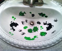 There's a real FISH PARTY going on in this bathroom sink!  Sally used a combination of decals from Sinkadoodles including the Coi fish from the Asian B design collection as well as the Fish from the Accents category.