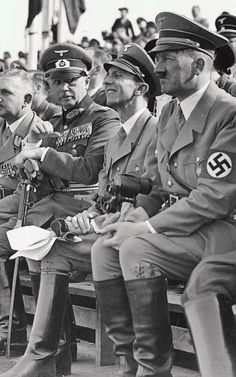 Bueckeberg 1937  It looks like Joe said something pithy that caught the monocled guy's attention but left Hitler nonplussed.  Hitler looks hot here - body temperature hot that is.