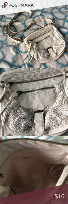 """Crochet Faux Leather Crossbody Off white / oatmeal colored faux leather crossbody purse with crochet detailing and antique gold hardware. 2 functional front zipper pockets, zipper closure at top, and one interior zipper pocket. Interior of purse and inside of pockets are clean and free of stains. Adjustable strap with 24"""" max shoulder drop. Dimensions: 8.5"""" x 9"""" x 2.5"""". Good used condition with minor flaws: some discoloration to hardware and minor wear to faux leather when inspecting…"""