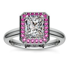 Dreamy pink sapphires surround a gorgeous, sparkling Radiant-cut diamond on a sleek, plain band... One definitely sweet proposal gift for your significant other. Pop the question with the Halo Pink Sapphire Gemstone Engagement Ring in sturdy Platinum!  http://www.brilliance.com/engagement-rings/halo-pink-sapphire-gemstone-ring-platinum