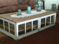 From the hog house to your house. Coffee table I made with windows my sister and I tore out of an old farrowing house on Friday. Has a shelf and will soon have little crystal lights. Love it and I think it looks great in my sister's living room. Now to make me one. Shabby Sister Chic!!!