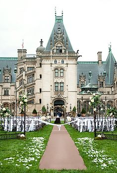 Biltmore Estate Asheville, North Carolina; a 250-room chateau built for George Vanderbilt in 1895. A theatrical ceremony on the front lawn, followed by cocktails on the Library Terrace and a tented reception with sweeping views of the Blue Ridge Mountains