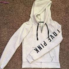 "Grayish white Victoria's Secret PINK hoodie Grayish white with ""LOVE PINK"" down the arm and heart on back. Gently worn. PINK Victoria's Secret Jackets & Coats"