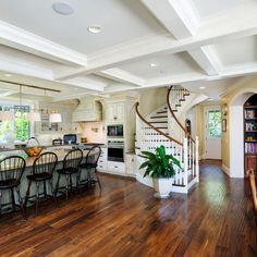 cute layout. love the curve of the staircase with the curve of the archway into the study; nice open kitchen