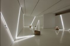 Wood and neon become an unlikely combination in the artist's site-specific installation
