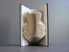 How to fold books into words!  Finally figured out how to do this.