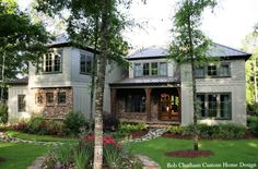 Designed for a coastal community on the eastern shore of Mobile Bay, this environmentally friendly home captures the essence of living green. Its heavy cypress columns, open rafter tails and stone finished porches create a casual earthy living atmosphere. Designed By: Bob Chatham  #homedesign #customhome #coastalliving #southernliving #homedecor #Fairhope #frenchdoors #interiordesign #bobchatham #home #garden #rustic #countryhome #greenliving #greenhome