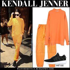 Kendall Jenner in orange sweatshirt and orange sweatpants
