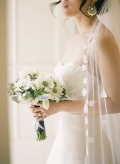 we have a MAJOR crush on this beautiful Bride's style. that veil is everything.  Photography by http://tanjalippertphotography.com