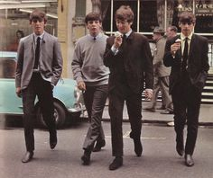 "Dezo Hoffman's photo of The Beatles crossing Wardour Street in front of Garners Restaurant. A moment in Dezo Hoffmann's ""A Day in the Life of The Beatles"" photo session of July 2, 1963."