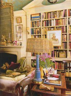 Hamish Bowles bookcase, velvet, blue lamp, warm metals & gilding, art placement