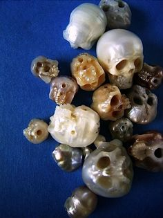 Normally I'm not a fan of skull jewelry designs, but these intricately carved pearl skulls are really, really well done. Tokyo-based jewelry designer, Shinji Nakaba, creates these delicate-looking skull rings and skull brooches.  I'd love to see an entire skull pearl necklace by Nakaba, but sadly I didn't see one on his website. Hopefully he sees this and considers making one. Now that would be a statement necklace! Exquisite stuff, but since no prices are listed, I'm assuming the prices ...
