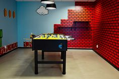 Spotify office in Stockholm, Super Mario themed Foosball room. Interior design concept by Adolfsson & Partners.