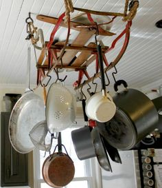 Hanging pot rack from an old sled. Great way to repurpose!