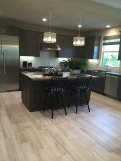 Check out our Aequa #woodlooktile in this beautiful install at Cressa in Portola Hills. https://arizonatile.com/en/products/porcelain-and-ceramic/aequa#utm_sguid=152185,634b2a77-360e-ae85-bba0-f791f6b58978 @TheNewHomeCo. Model designed by Meridian Interiors.