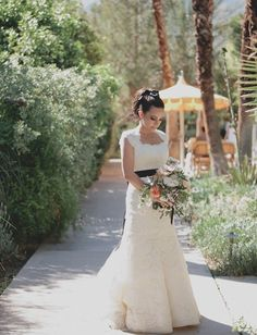 love this gorgeous bride and her black hair bow