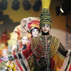 "Models present creations by Bali designer Paul Ropp as part of his ""Ethnic Extravaganza"" collection during the Islamic Fashion Festival in Kuala Lumpur"