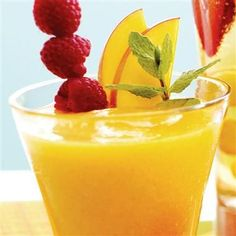 Blend mangoes, ice, orange juice and rum and raspberry extracts for a delightful summer mocktail.