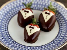 Strawberries dipped in white and dark chocolate, like a sir!